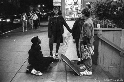Skate punks on Telegraph Avenue at night.