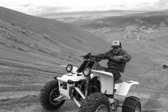 Guy on 4 wheel ATV on Sand Mountain.
