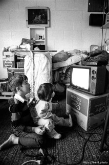 Kids watching tv. People living in the Hideaway Motel.