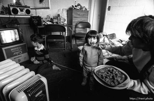 People living in the Hideaway Motel. Girl being fed.