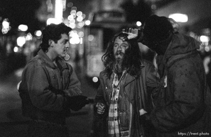 Drunk and street men on Market Street at night.