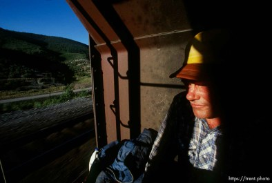 Casey riding a train to Helper.
