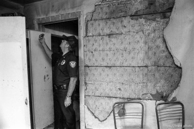 Eureka Police Chief Fullmer in an abandoned home.