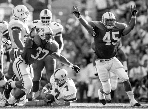 BYU players celebrate sacking Miami QB at BYU vs. Miami football.