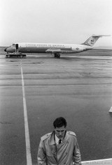 Secret Service agent and plane during a visit by Vice President Dan Quayle.