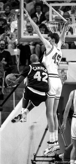 Tall Shawn Bradley with little player going against him at BYU vs. Arizona State.