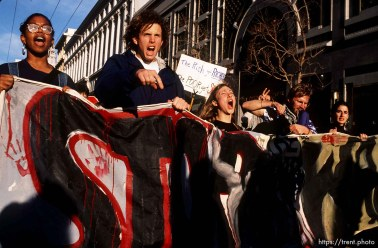 Protesters parade and yell on Market Street at Gulf War protest.