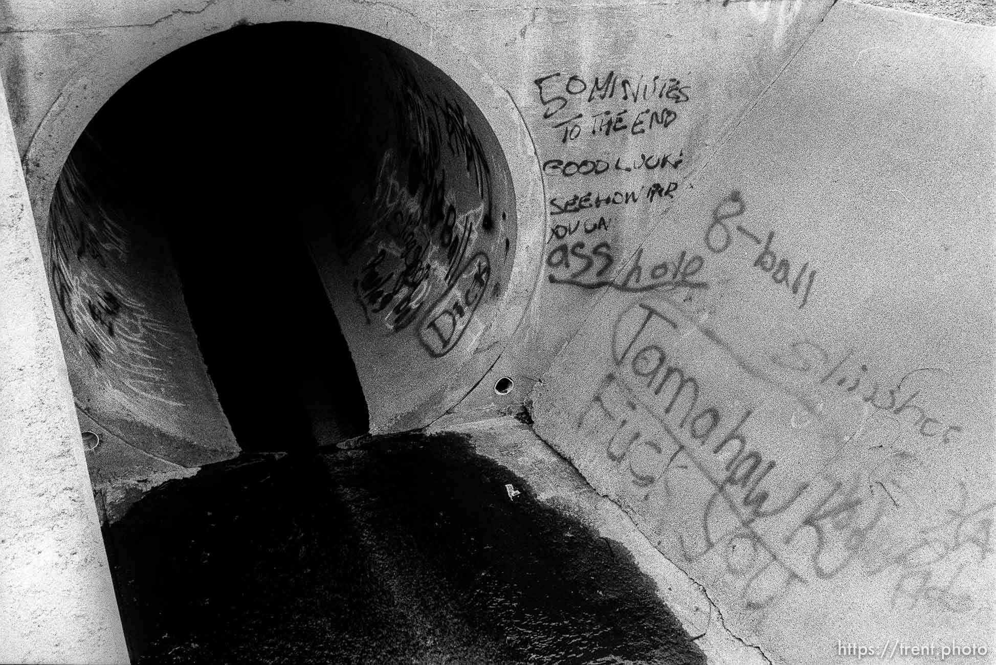entrance to sewer pipe.