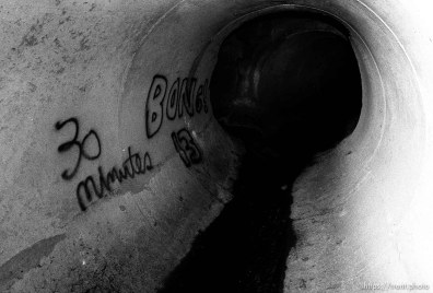 graffiti in sewer pipe.