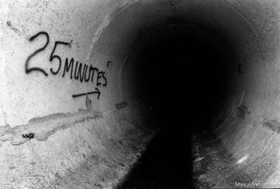 graffiti in sewer pipe.