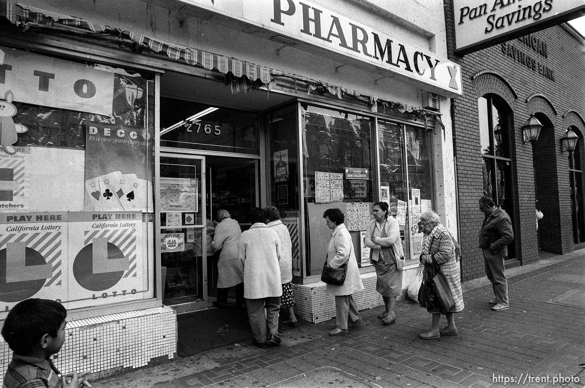 People lined up to get into pharmacy