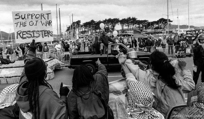 Man flips off floats at Gulf War celebration parade.