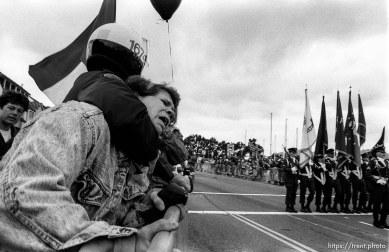 Police arrest man at Gulf War celebration parade.