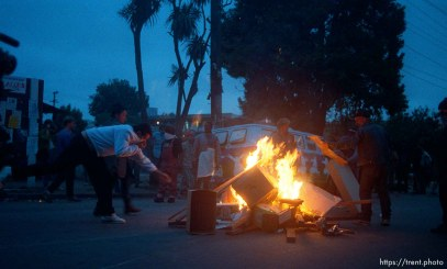 Protesters start a fire during riots and protests.