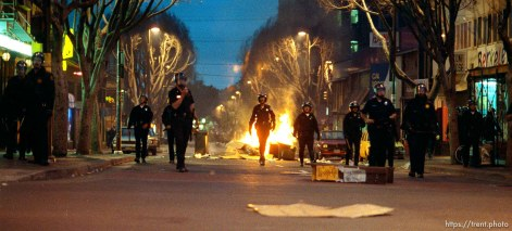 Police advance on rioters during riots and protests.