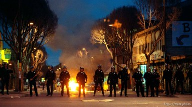Police line and fires during riots and protests.