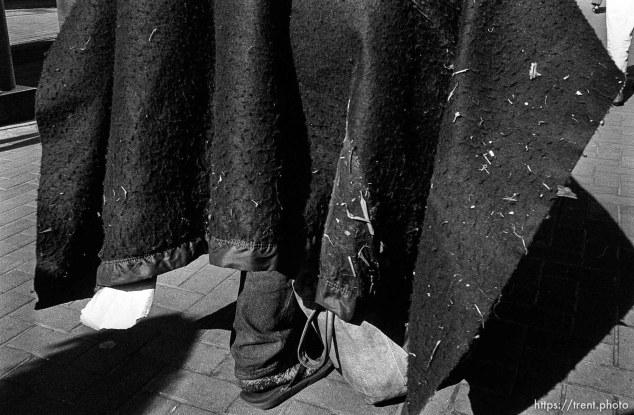 Homeless man walking (his feet)