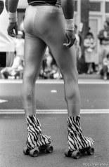 Funny rollerskater's legs in Carnaval parade