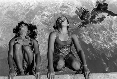 Girls putting their hair in the water at the Las Trampas Pool.