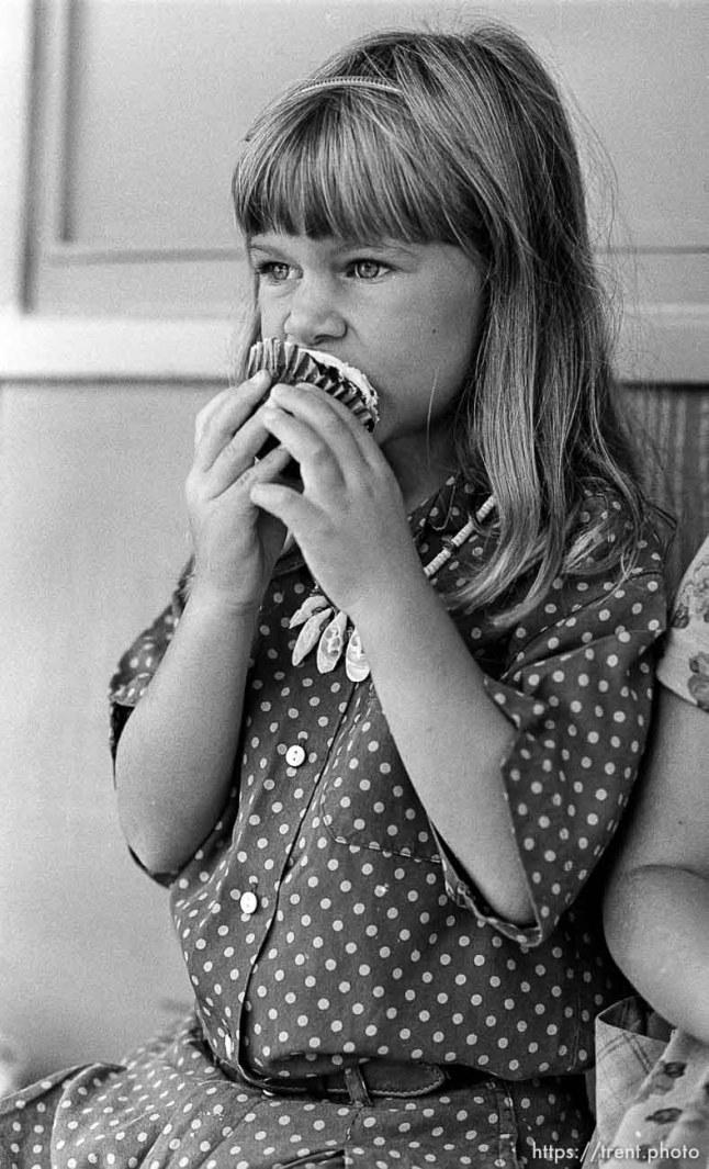 Girl eats cupcake on the first day of kindergarten (Mrs Griebstein's class).
