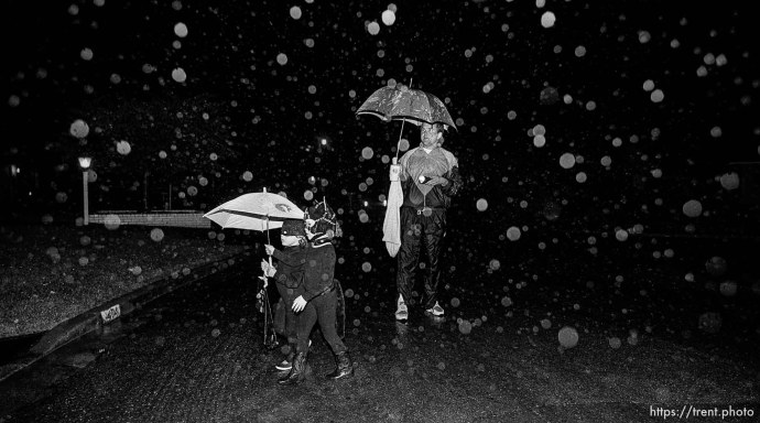 Trick-or-treaters in rain on Halloween
