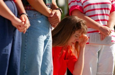 Woman prays at Operation Rescue abortion protest at Planned Parenthood clinic.