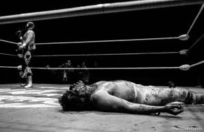 Wrestling action at Luche Libre pro-wrestling. guy covered in blood