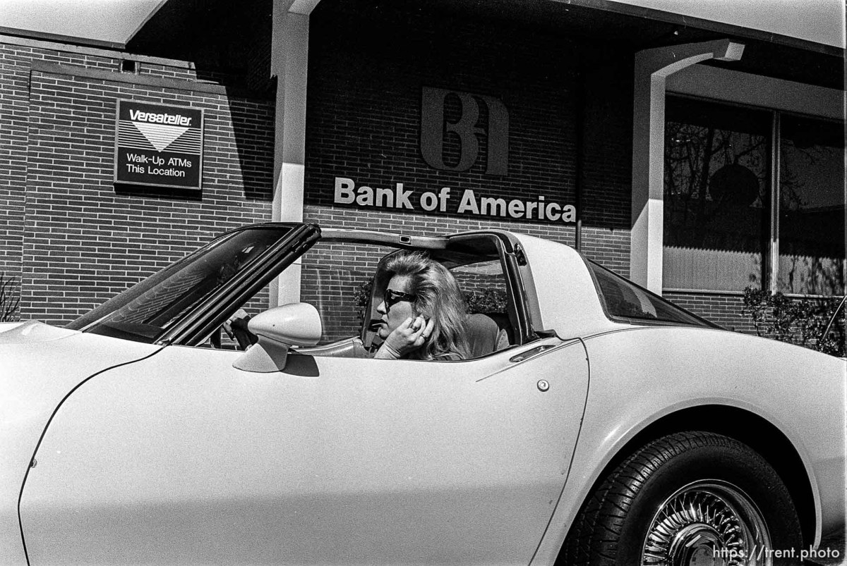 Woman in corvette in front of Bank of America