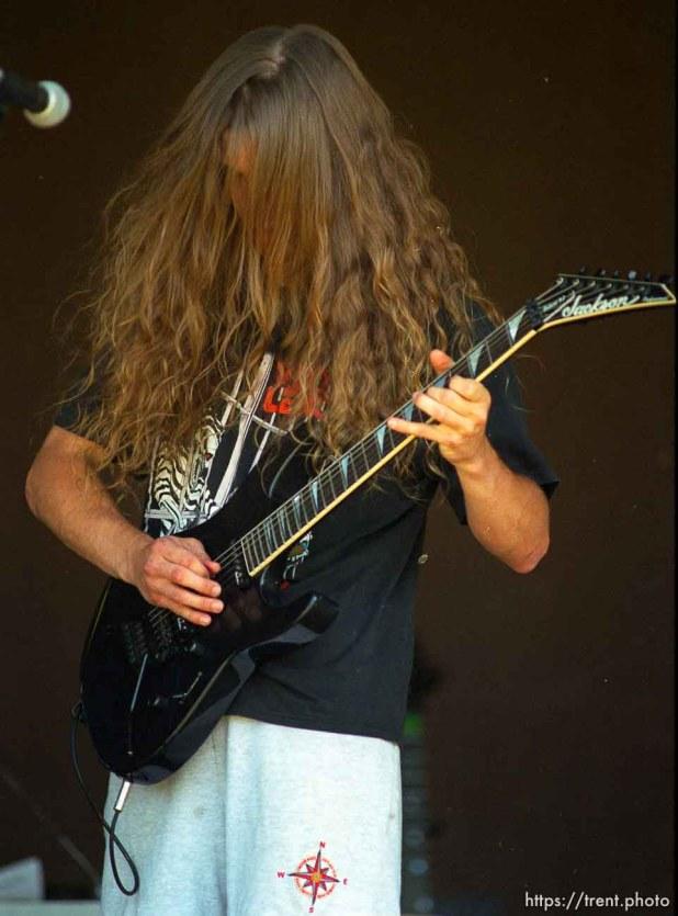 Long-haired guitarist at Bands in a Blender concert.