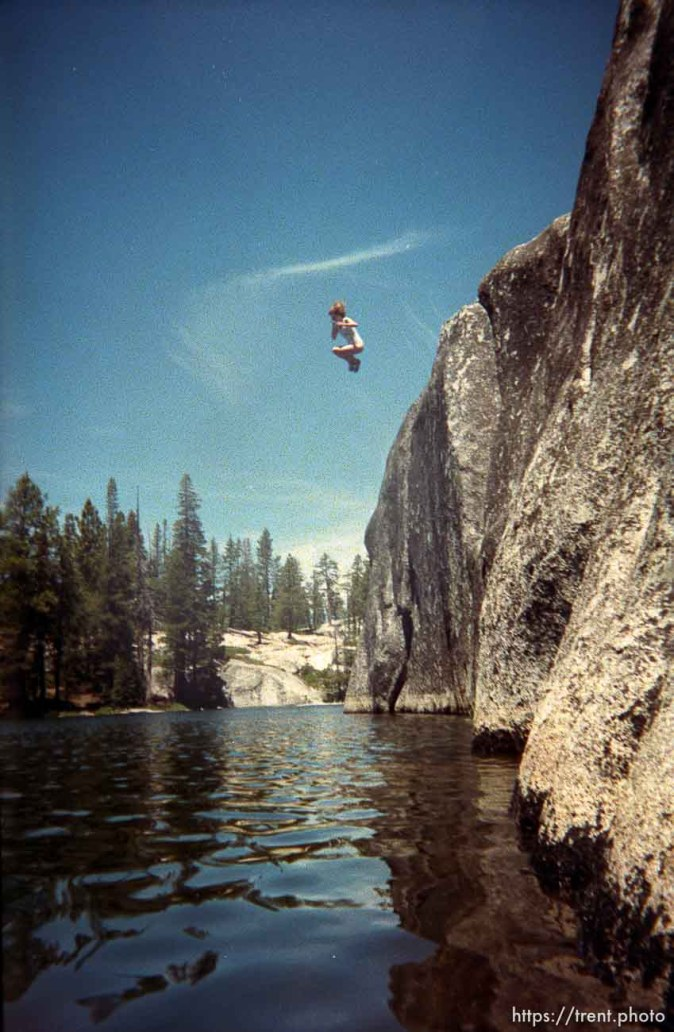 Laura Nelson jumping off the cliff at Sword Lake
