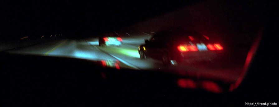 A carload of Oriental Posse members (right) races down the Bangerter Highway.