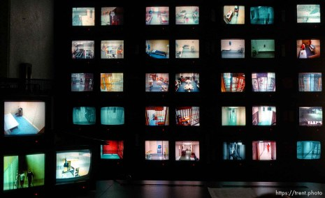 A panel of video monitors provides deputies at the Utah County Jail views of cells and rec areas. Due to overcrowding, physical surveillance has been regulated to the cameras. photo by trent nelson 19960321