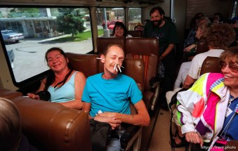 Guy on fun bus with cigarettes in his face.