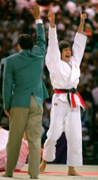 Woman wins gold medal in Judo at the 1996 Summer Olympic Games