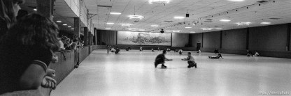 """People doing """"shoot the duck"""" at Golden Skate"""