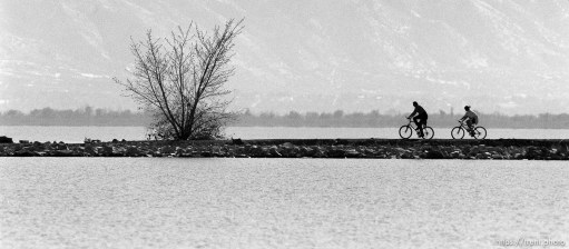 Sam Lunt and his niece Marilyn Knudsen ride their new mountain bikes along the south causeway at Utah Lake, provo.