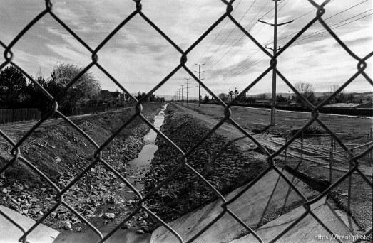 San Ramon Creek, through chain-link fence