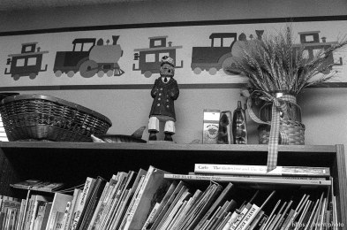 Books and sailor carving in the pre-school room in the Nelson home.