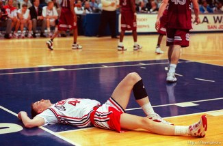 Keith Van Horn laying on the ground at Utah vs Stanford, NCAA Tournament.