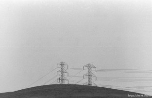 Powerlines and hill and sky