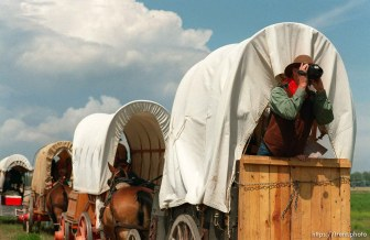 Lee Johnson of Spanish Fork, UT videotapes wagons on the Mormon Trail Wagon Train.