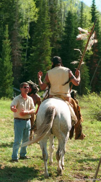 "Director Lyman Dayton talks with actor Russell Means while filming of the movie ""Windy River."""