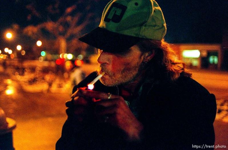 Robert William Smith, homeless in Salt Lake City, lights up a cigarette.