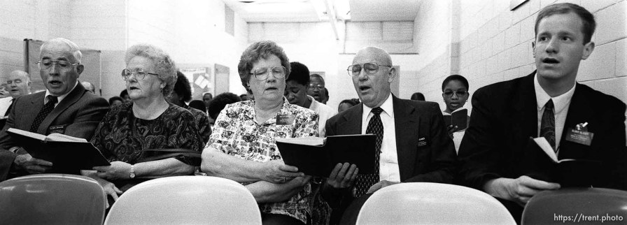 Missionaries sing hymns in sacrament meeting during an LDS church service.