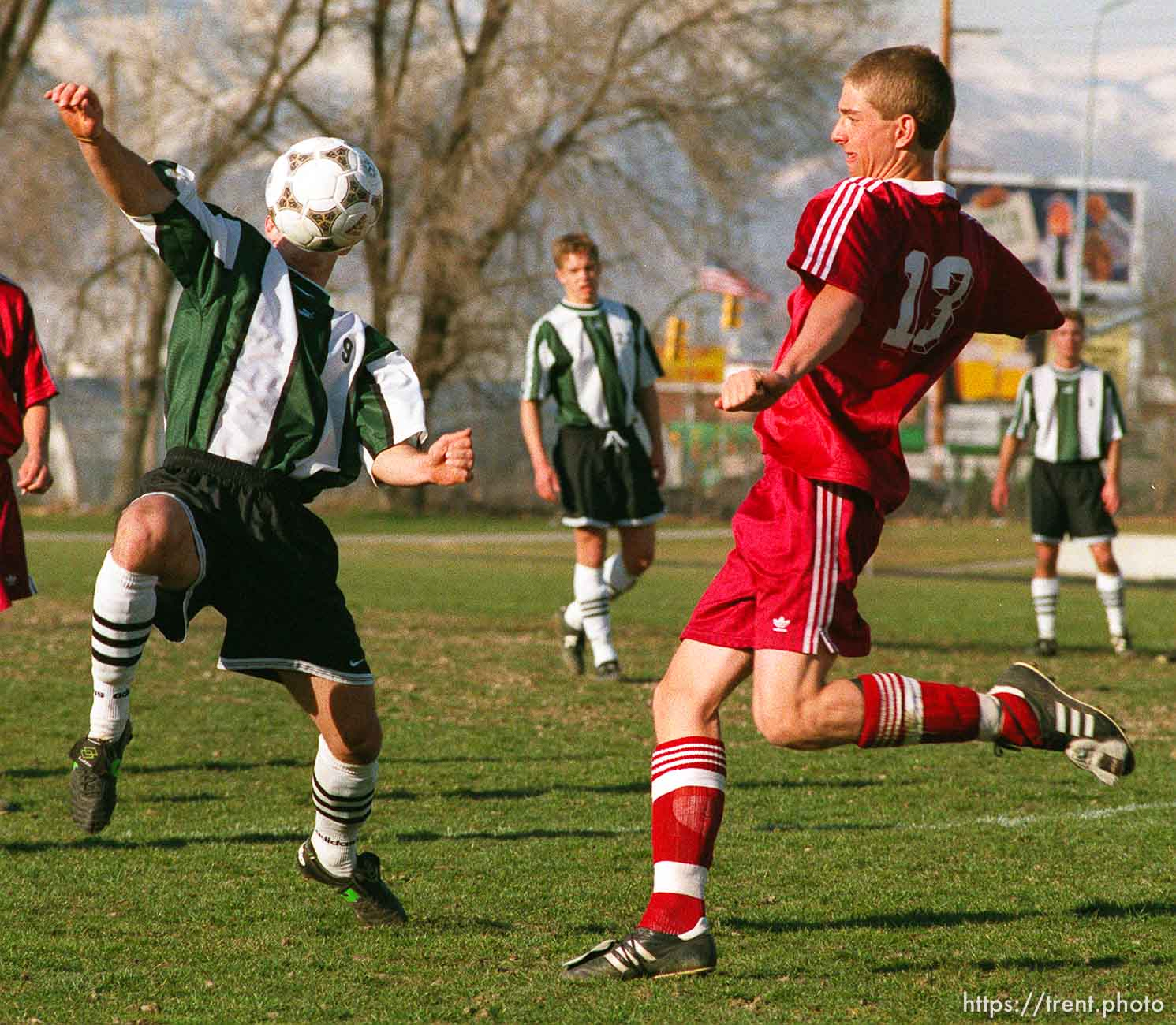Mountain View HS at Hillcrest HS soccer. Ball head. Hillcrest's James Crowley (left) and MV's Brad or Tim Johnson (there were two #13's).