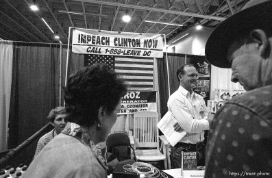 """""""Impeach Clinton Now"""" and water purifier exhibit at the Emergency Preparedness Expo at the Salt Palace Convention Center."""
