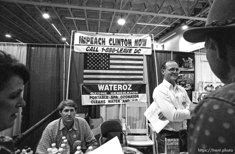 """Impeach Clinton Now"" and water purifier exhibit at the Emergency Preparedness Expo at the Salt Palace Convention Center."