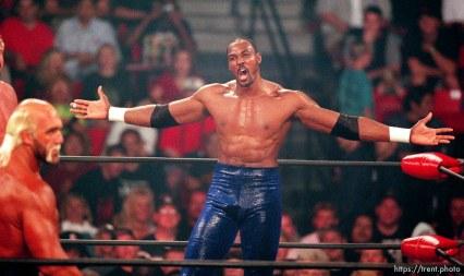 Karl Malone taunts Hollywood Hulk Hogan at WCW's Bash at the Beach.