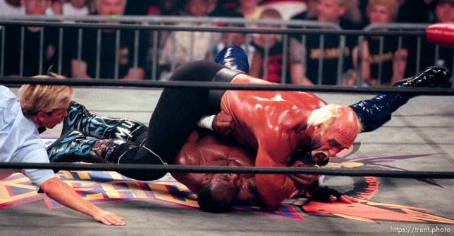 Karl Malone and Hollywood Hulk Hogan wrestle at WCW's Bash at the Beach.