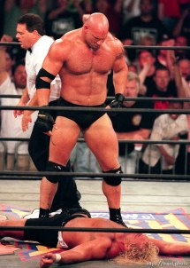 Goldberg looks down at defeated Curt Hennig at WCW's Bash at the Beach.